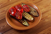 Roasted eggplants with tomato and bell peppers — Stock Photo