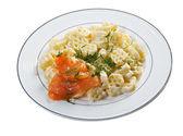 Ruote pasta with cream sauce — Stock Photo