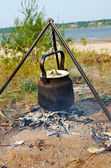 Teapot on the campfire — Foto Stock