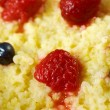 Millet porridge with berry — Stock Photo