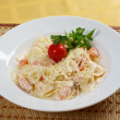 Farfalle pasta with salmon — Stock Photo