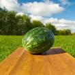 Watermelon on a wooden table — Stock Photo