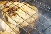 Codfish steak on the grill — Stock Photo