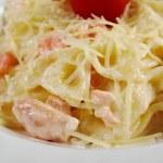 Farfalle pasta with salmon — Stock Photo