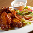 Roasted chicken wings on plate — Photo