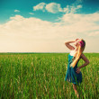Woman on green grass on background — Stock Photo