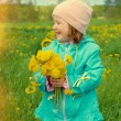 Small girl  on meadow  — Stock Photo