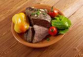Sliced rare roast beef farm-style — Stock Photo