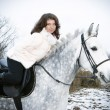Girl on a horse.winter landscape — Stock Photo