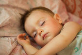 Breast child sleeps — Stock Photo