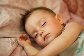 Breast child sleeps — Stock Photo