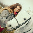 Stock Photo: Beautiful girl-gypsy with horse.