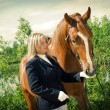 Stock Photo: Girl -jockey and horse