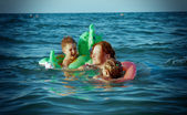 Family in the waves — Stock Photo