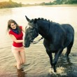 Girl and her handsome horse. — Stock Photo
