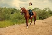 Girl horseback on jumps  — Stock Photo