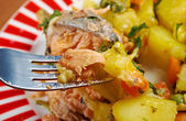 Baked trout with potatoes — Stock Photo