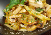 potato and mushroom stir fried — Stock Photo