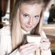 Happy teenage girl teenage girl holding a cup — Stock Photo #46404229