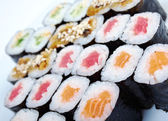 Roll made salmon, eel, tuna, vegetables — Stock Photo
