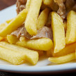 Slice pork  and french fries — Stock Photo #50010529