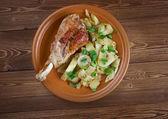 Turkey leg with baked  potatoes  — Stock Photo