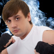 Portrait of the young fighter in a smoke — Stock Photo #1209706