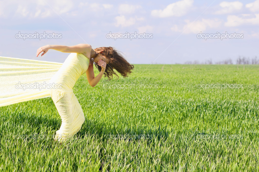 Expressive flexible young woman wrapped in yellow cloth    — Stock Photo #13435561