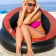 Joyful girl sitting in an inflatable chair — Stock Photo #13503501