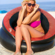 Joyful girl sitting in an inflatable chair — Stock Photo