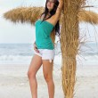 Young woman on a beach — Stock Photo