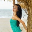 Portrait of a nice young woman on beach - Stock Photo