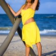 Beautiful young woman in a yellow dress — Stock Photo