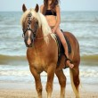 Teen girl riding a horse — Stock Photo