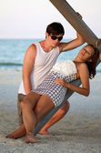 Beautiful young couple on the beach — Stock Photo