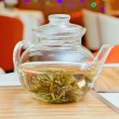 Teapot with green tea - Stock Photo