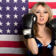 Young blonde with boxing gloves — Stockfoto