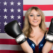 Smiling young blonde with boxing gloves — Stock Photo