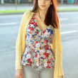 Pretty brunette in flowered blouse — Stock Photo