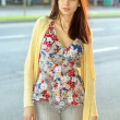 Stock Photo: Pretty brunette in flowered blouse