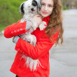 Brunette hugging little dog — Stock Photo