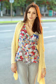Pretty brunette in flowered blouse — Stock Photo