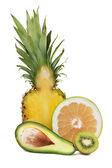 Avocado, pineapple, sweetie and kiwi — Stock Photo