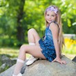 Little girl in jeans dress — Stock Photo #49260889