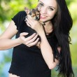 Cheerful brunette posing with little dog — Stock Photo #49261097