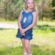 Little blond girl in jeans dress — Stok fotoğraf #49261621