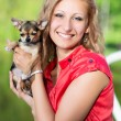 Blond woman posing with a small dog — Stock Photo #49262275