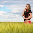 Thoughtful young lady on the wheat field — Stock Photo #49263687