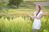 Seductive young blonde on the meadow — Stock Photo