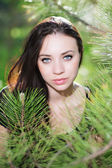 Brunette posing near the pine tree — Stock Photo